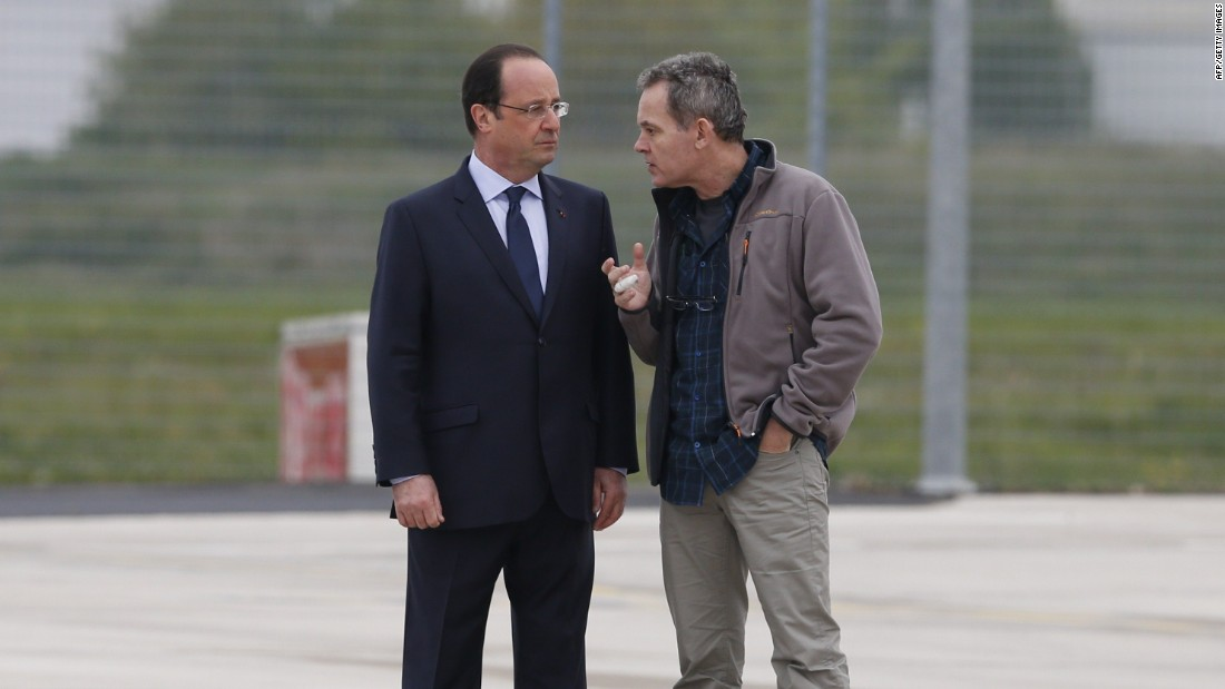 French Prime Minister Francois Hollande speaks with François at Villacoublay air base.