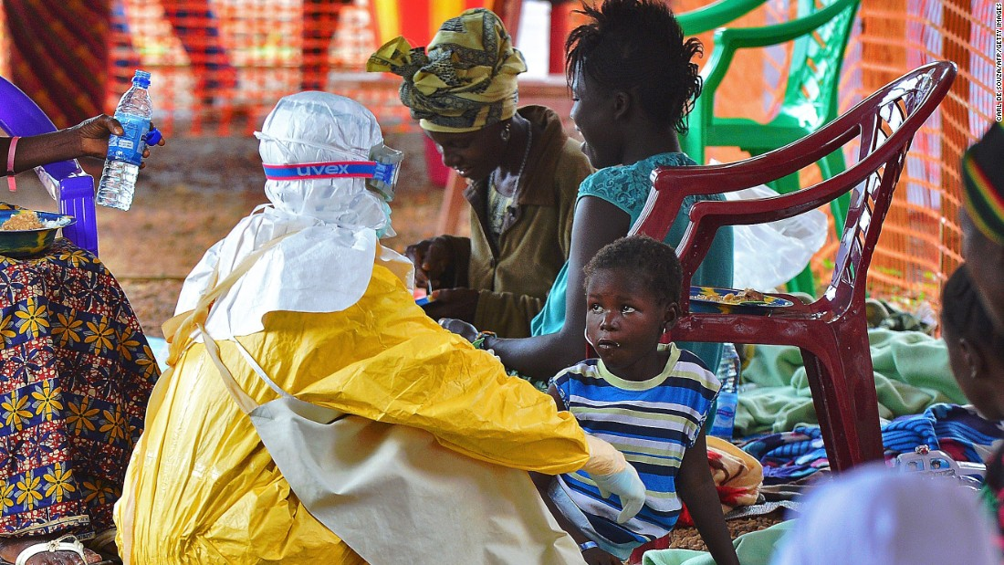 Although the 2014 Ebola outbreak reached nine countries (with the epicenter in three countries), it remains defined as an outbreak, rather than a pandemic, because it has not spread globally. Here, an MSF medical worker feeds a child with Ebola in Kailahun, Sierra Leone.