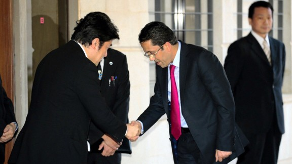 Japanese Vice Foreign Minister Yasuhide Nakayama, left, shakes hands with a Jordanian lawmaker visiting the Japanese Embassy in Amman on February 2. Two Japanese hostages, Haruna Yukawa and Kenji Goto, were also recently killed by ISIS.
