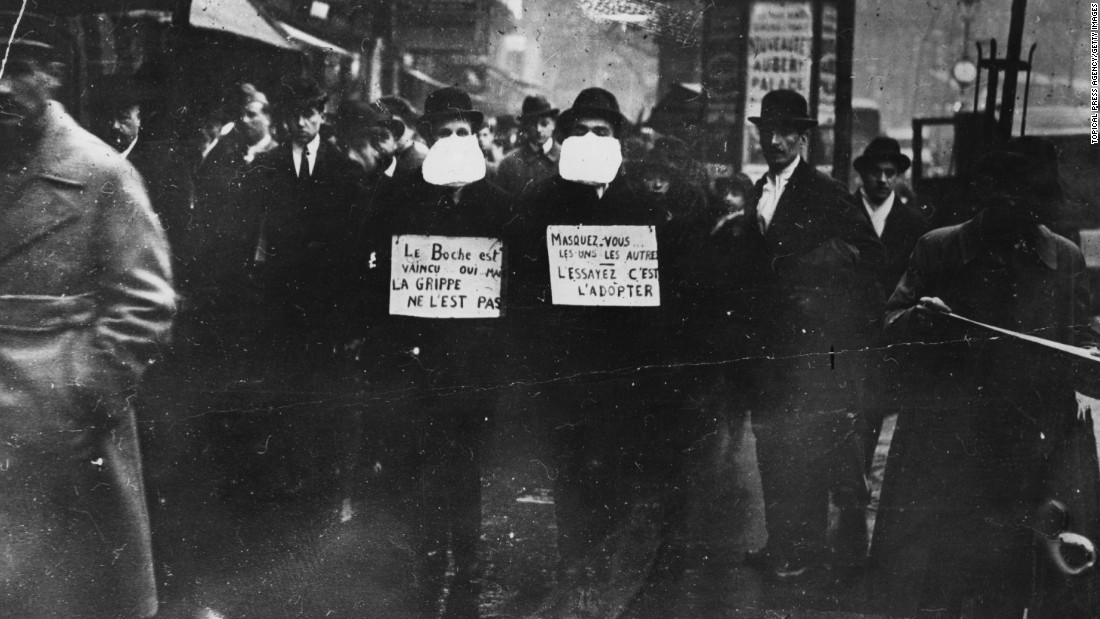 The greatest pandemic to date was Spanish flu, which spread in 1918 and is estimated to have infected a third of the world's population at the time and caused approximately 50 million deaths. Two men wearing and advocating the use of flu masks in Paris during the Spanish flu epidemic in March 1919.