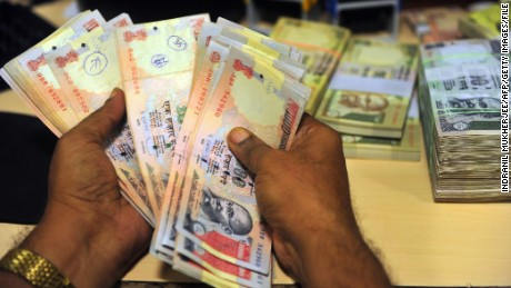 An Indian employee looks for illegal Indian rupee currency notes at a bank in Mumbai on September 3, 2013. India's currency slid sharply and the share market crashed nearly 3.5 percent in another major sell-off caused by uncertainty in the Middle East and a new gloomy economic forecast by Goldman Sachs. The rupee, the worst performing major currency in Asia this year, skidded 3.25 percent to 68.15 to the dollar as shares closed down 651 points or 3.45 percent to 18,234.66 points. AFP PHOTO/ Indranil MUKHERJEE (Photo credit should read INDRANIL MUKHERJEE/AFP/Getty Images)