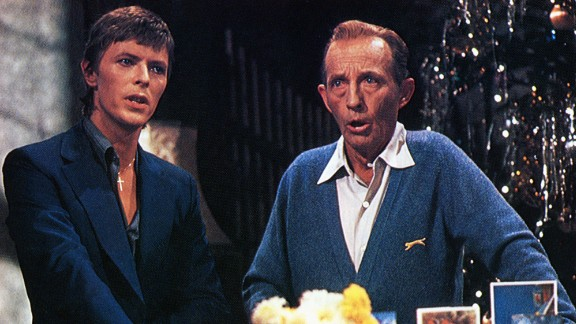 """David Bowie once again had an unusual musical partnering, this time with Bing Crosby<a href=""""http://www.washingtonpost.com/wp-dyn/content/article/2006/12/19/AR2006121901260.html"""" target=""""_blank"""" target=""""_blank"""">. In 1977, composers worked frantically to rearrange """"Peace on Earth/ Little Drummer Boy"""" </a>to a version that Bowie would agree to sing with Crosby on the latter's Christmas special. They  succeeded and the result is Christmas magic."""