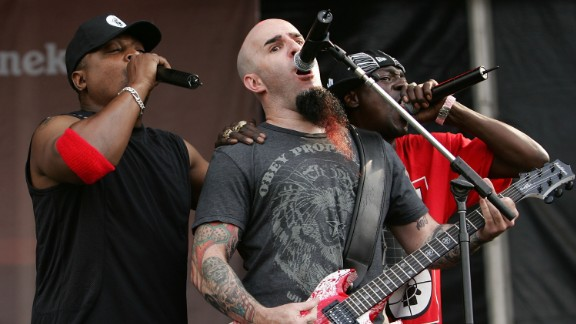 """Metal met rap when the band Anthrax teamed with Public Enemy for a new version of the latter's hit """"Bring the Noise."""" Here Anthrax guitarist Scott Ian, center, performs with Chuck D and Flava Flav of Public Enemy perform on stage at the """"Rock The Bells"""" tour in July 2007 in New York."""