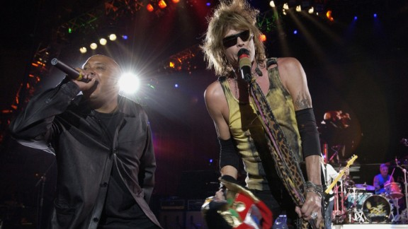 """Aerosmith and Run DMC  perform in August 2002. Run DMC covered the rock group's """"Walk This Way"""" on their """"Raising Hell"""" album in 1986. It is the grandfather of all """"rock rap."""""""