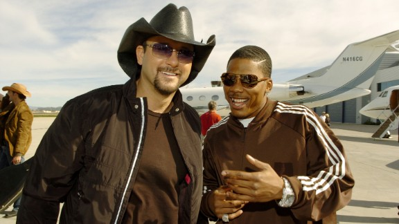 """After recording their 2009 hit """"Over and Over,"""" country singer Tim McGraw and rapper Nelly linked up again, this time to film a Budweiser commercial."""