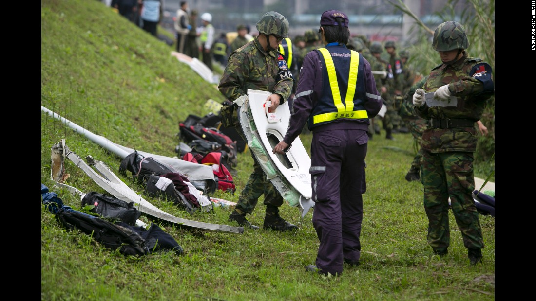 Debris from the plane crash is lined up along the riverbank on February 4.