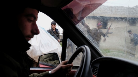 Members of the YPG make their way to the front line of the battle with ISIS on January 31.