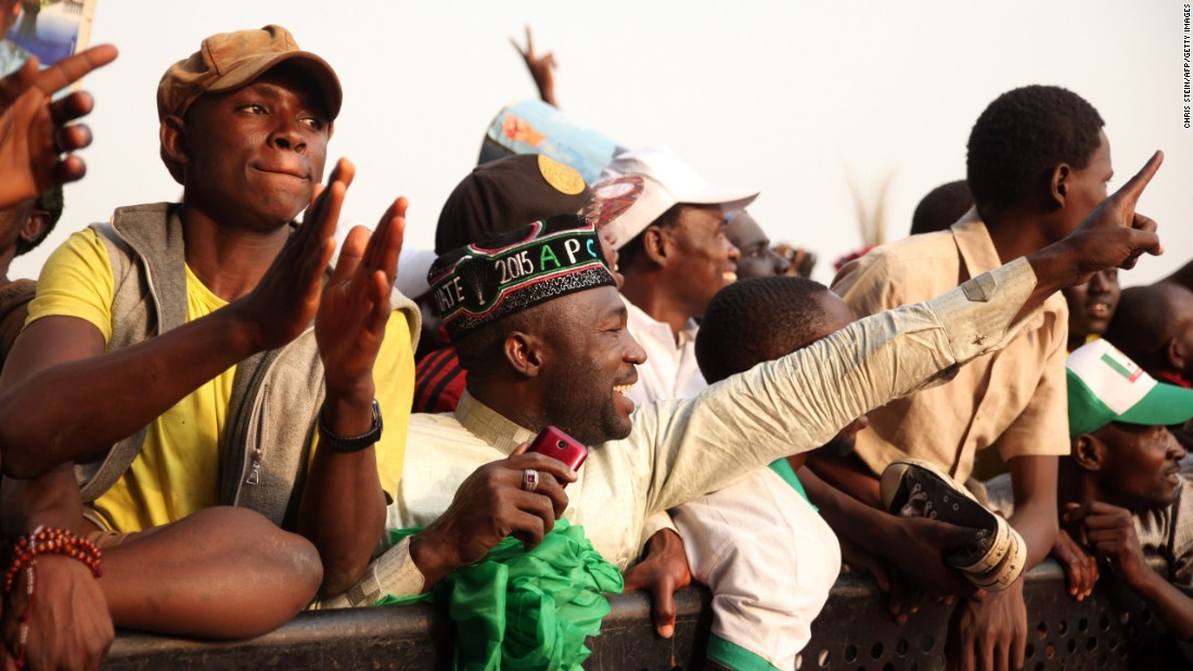 A becapped APC supporter attends a rally in Kuduna on January 19.