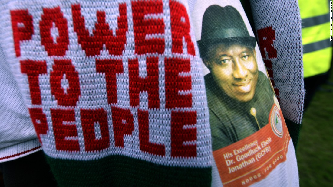 A PDP supporter dons knitwear and a shirt emblazoned with incumbent Goodluck Jonathan's face at a rally on January 28.