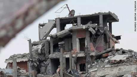 Destruction in the center of Kobani on January 30. The city sits on the border with Turkey.