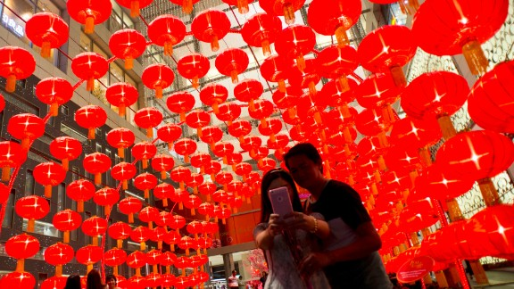A couple takes a selfie against traditional Chinese lanterns at a shopping mall in Kuala Lumpur, Malaysia, on Wednesday, January 28.
