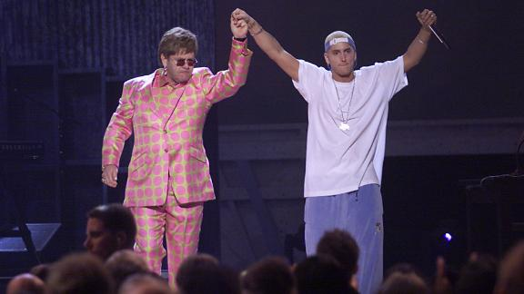 """Elton John and rap artist Eminem seemed to be the oddest of pairs, given the rapper's well-known homophobic lyrics and comments. But the two came together to perform Eminem's song """"Stan"""" at the 43rd Annual Grammy Awards in 2001."""
