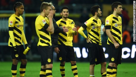Borussia Dortmund players react to their 1-0 defeat against Augsburg Wednesday.