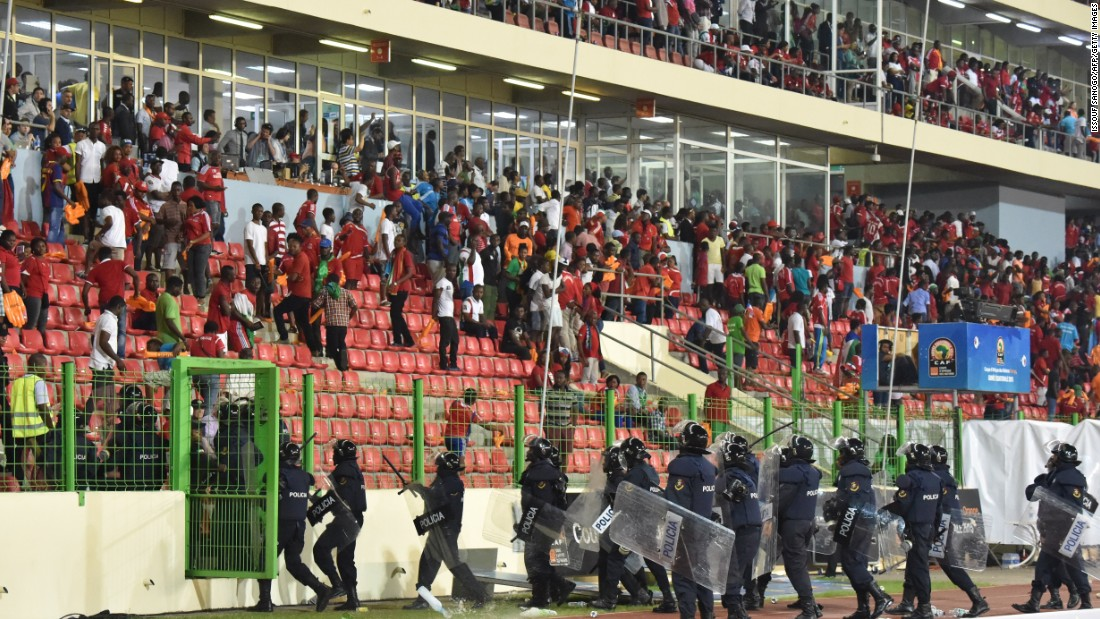 Play was stopped eight minutes from full-time when Equatorial Guinea fans apparently aimed missiles as Ghana supporters.
