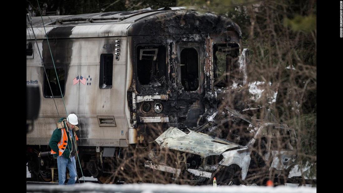 "Emergency personnel in Valhalla, New York, stand near the site of a collision that occurred between an SUV and a Metro-North commuter train on Tuesday, February 3. <a href=""http://www.cnn.com/2015/02/03/us/new-york-train-collision/index.html"" target=""_blank"">At least seven people died</a> and more than a dozen were injured, a rail official said."