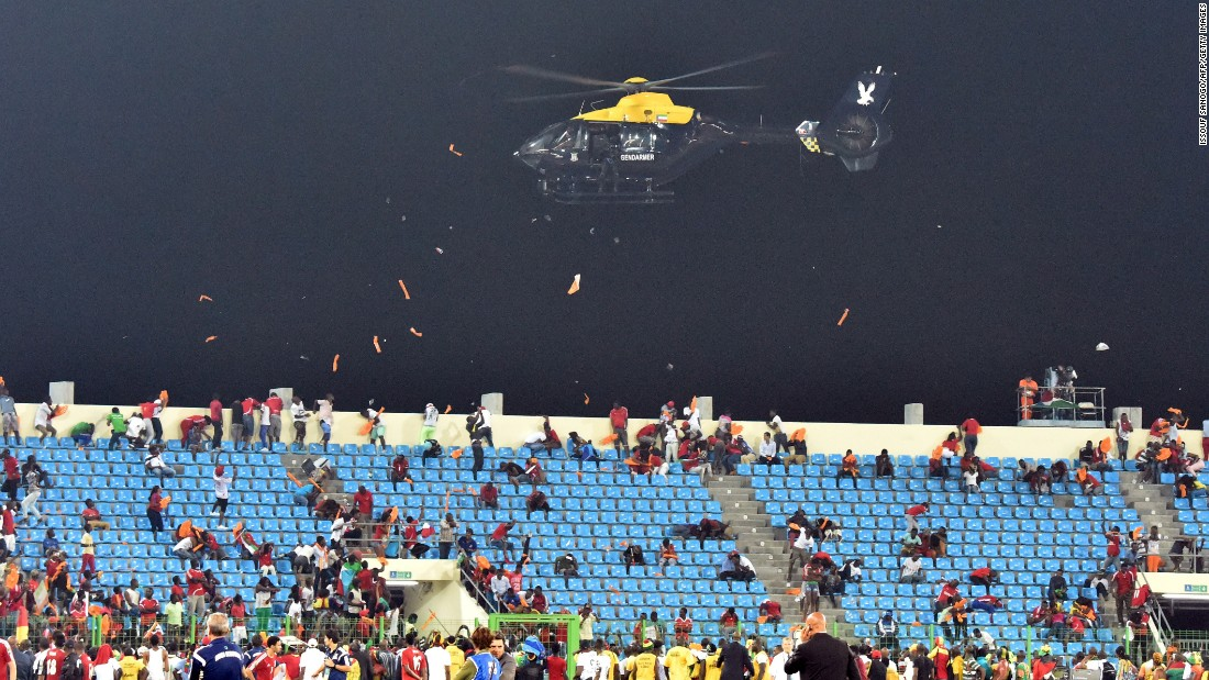 A police helicopter flies over the stadium.