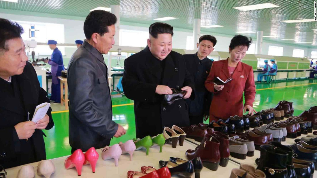 North Korean leader Kim Jong Un, third from left, visits the Wonsan Shoes Factory in Pyongyang, North Korea, in this undated photo released by North Korea's state-run news agency on Saturday, January 31.