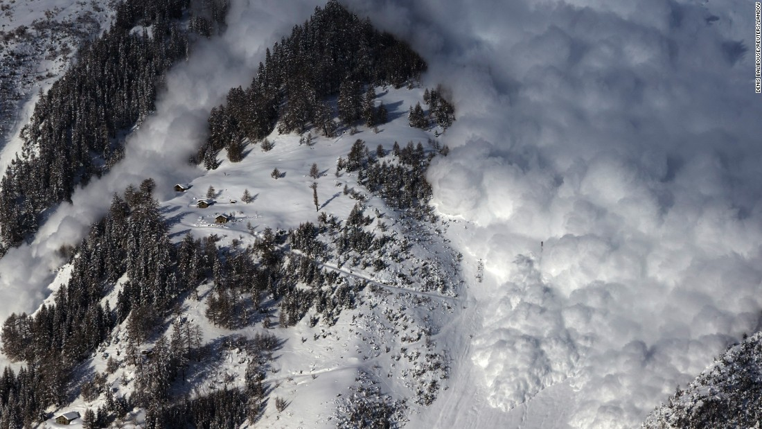 An artificially triggered avalanche thunders down a mountainside in Anzere, Switzerland, on Tuesday, February 3. It was part of a scientific test for the Swiss Institute for Snow and Avalanche Research.