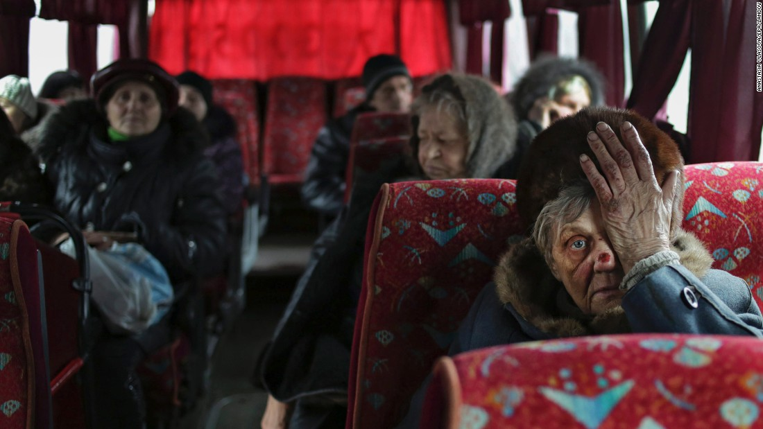 "People sit on a bus as they wait to leave the town of Debaltseve, Ukraine, on Tuesday, February 3. <a href=""http://www.cnn.com/2015/01/23/world/gallery/ukraine-crisis-2015/index.html"" target=""_blank"">Fighting between Ukrainian troops and pro-Russian rebels in the country</a> has left more than 5,000 people dead since mid-April, according to the United Nations."