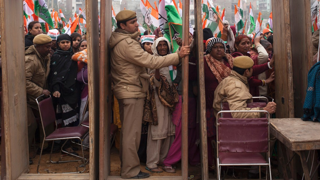 Supporters of India's National Congress Party wait to enter a campaign rally in New Delhi on Wednesday, February 4.
