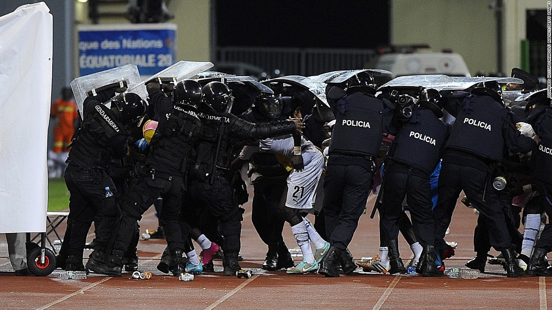 "Police protect soccer players with their shields as fans throw materials at halftime of an African Cup of Nations match played Thursday, February 5, in Malabo, Equatorial Guinea. There was also <a href=""http://edition.cnn.com/2015/02/05/football/afcon-semifinal-ghana-equatorial-guinea/index.html"" target=""_blank"">crowd trouble</a> in the second half as Ghana defeated the home country 3-0 to advance to the tournament final."