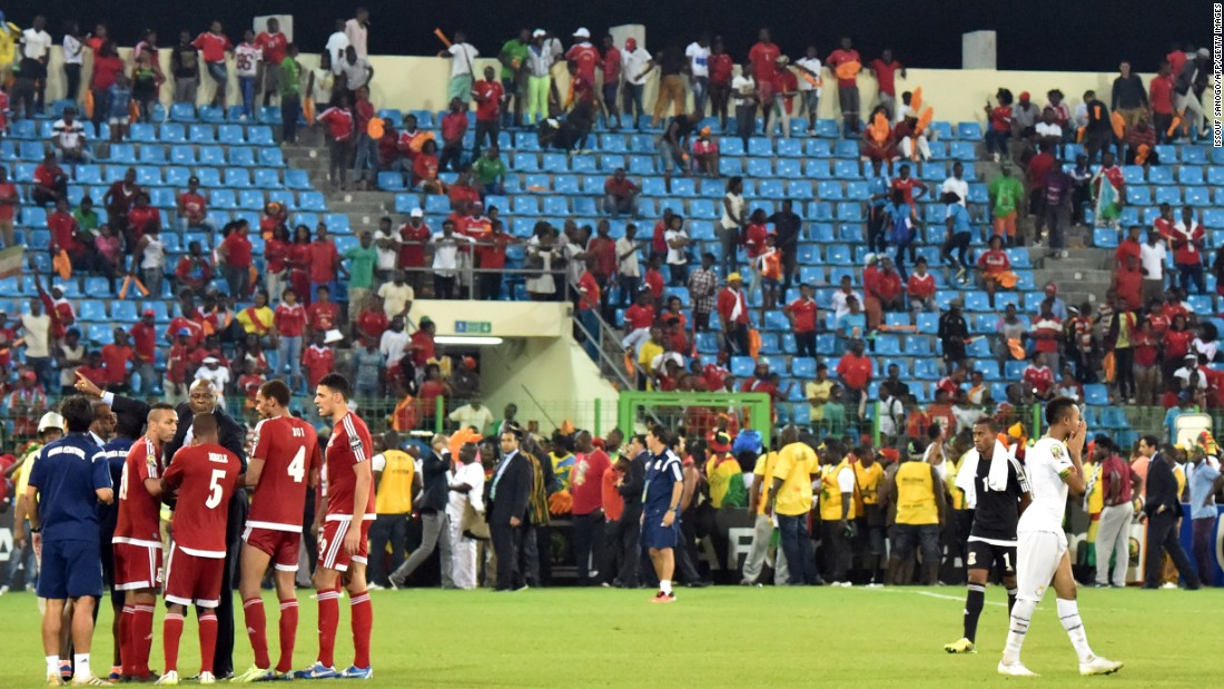 Both sets of players had to wait on the pitch as a decision was made whether to abandon the game or resume the action.