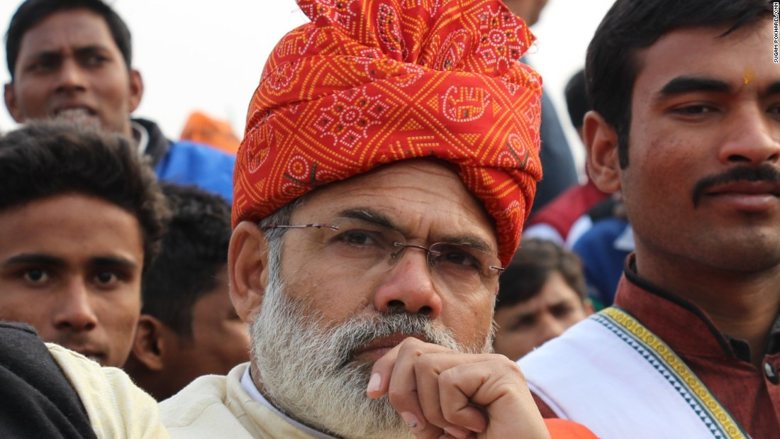 In his orange turban and saffron stole, and with a white lotus badge neatly pinned to his traditional Indian waistcoat, he bears a sartorial resemblance to the Prime Minister too.