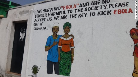 A message in Liberia explains to people who pass by that these people are Ebola-free and should be brought back into the community.