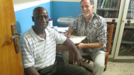Dr. John Fankhauser, right, and William Pewee meet at the ELWA hospital in Liberia.  Pewee is an ELWA Hospital staff member who is also an Ebola survivor.