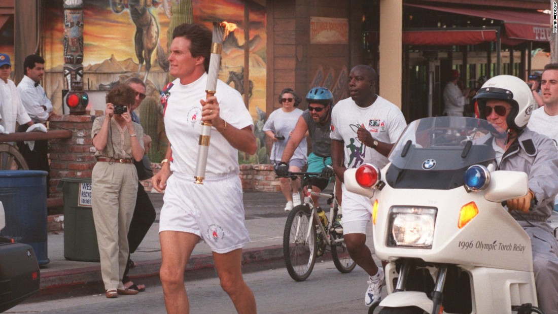 Jenner carries the Olympic flame down Sunset Boulevard in West Hollywood, California, on April 27, 1996.
