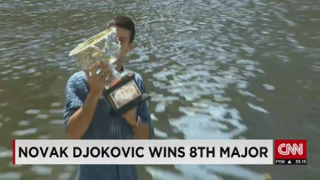 Novak Djokovic celebrates Australian Open win
