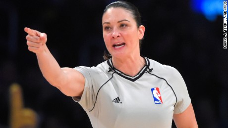 Lauren Holtkamp making a call during a game between the Los Angeles Lakers and the Orlando Magic.