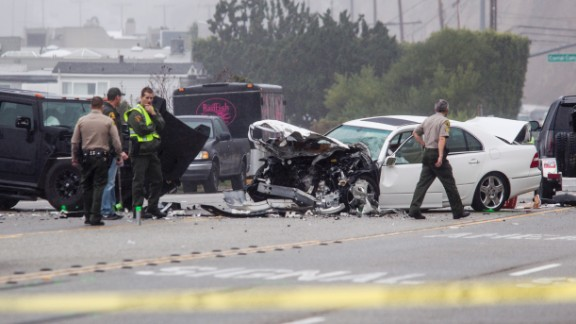 Members of the Los Angeles County Sheriff's Department work the wreck scene. Jenner was the driver of one vehicle, Deputy Ray Hicks told CNN.