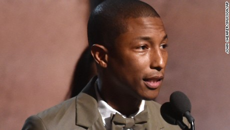 "Pharrell Williams collects his Grammy for best pop solo performance for ""Happy"" on February 8."