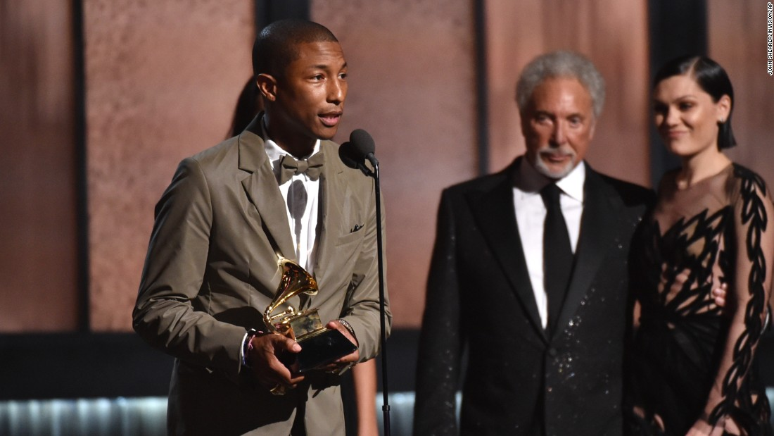 "Pharrell Williams accepts the Grammy for Best Pop Solo Performance for ""Happy (Live)."" The song also earned the Best Music Video award, and Pharrell's ""Girl"" was named Best Urban Contemporary Album."