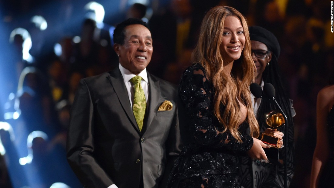 "Smokey Robinson presents Beyonce with the award for Best R&B Performance. ""Drunk in Love"" also took home the Grammy for Best R&B Song."