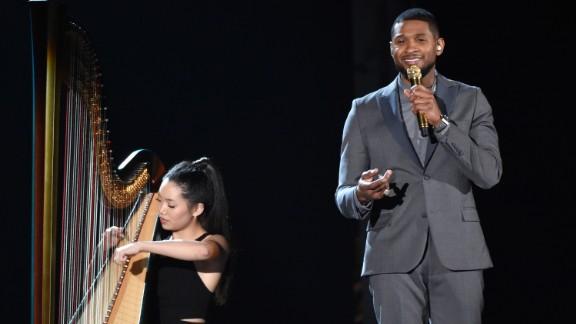 Usher, backed by a harp, sings Stevie Wonder