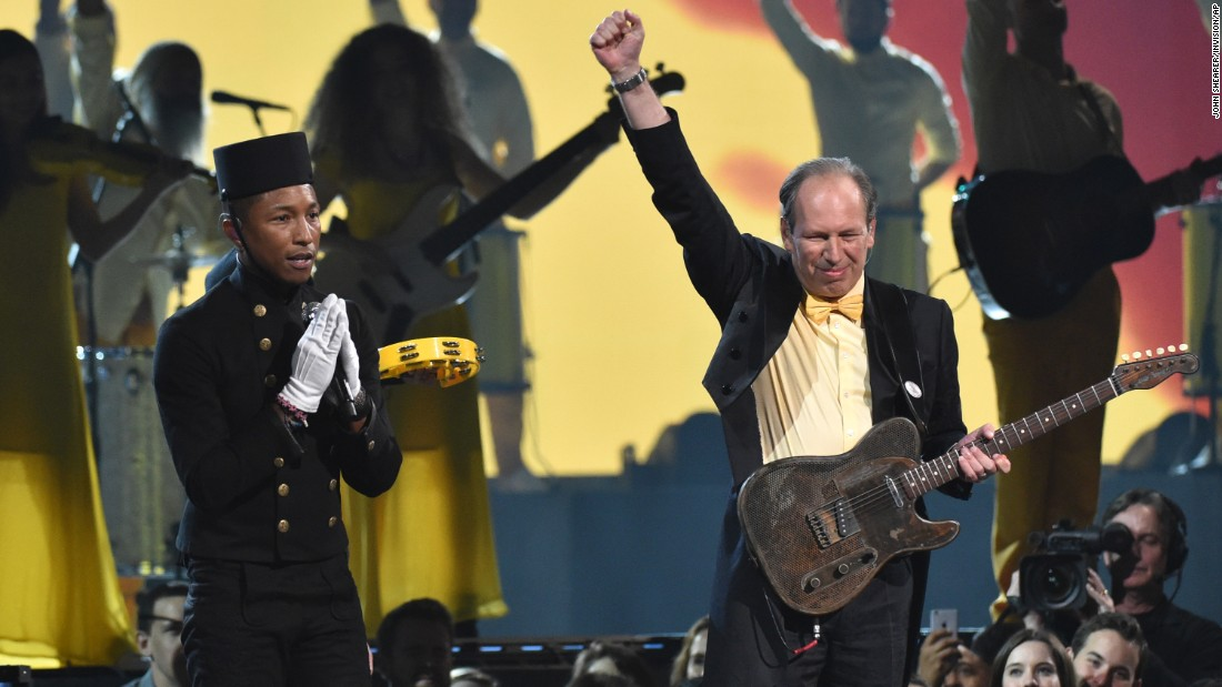"Pharrell Williams and Hans Zimmer perform ""Happy."""