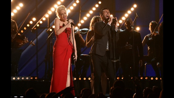 "Gwen Stefani and Adam Levine sing ""My Heart Is Open."""