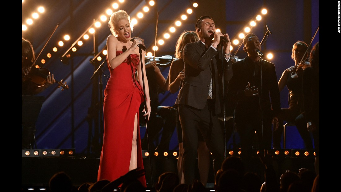 "Gwen Stefani and Adam Levine sing ""My Heart Is Open."""