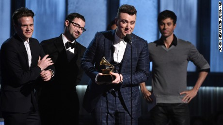 "William Phillips, from left, James Napier and Sam Smith accept the award for song of the year for ""Stay With Me"" at the 57th annual Grammy Awards on Sunday, Feb. 8, 2015, in Los Angeles. (Photo by John Shearer/Invision/AP)"