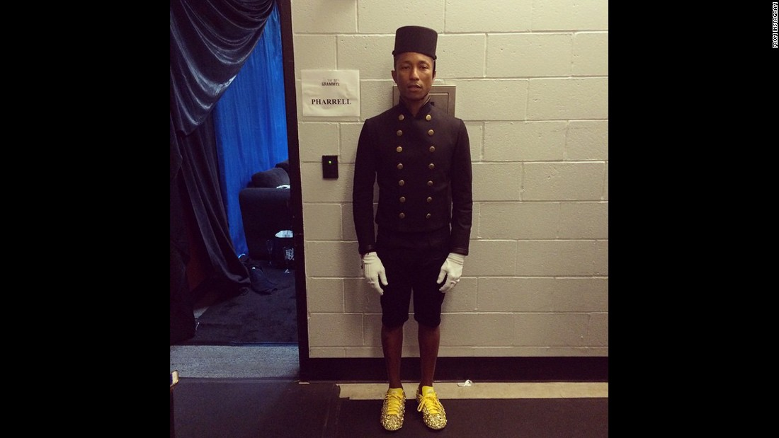 "Pharrell gets ready to perform. He was also the butt of a number of ""Grand Budapest Hotel"" jokes."