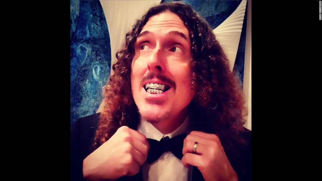 """Weird Al"" Yankovic, looking dapper, won a trophy in the preshow ceremony."