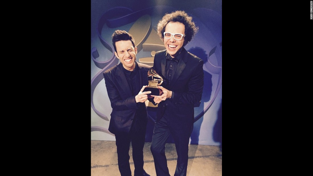 A Great Big World's Chad Vaccarino and Ian Axel take pride in their trophy for best pop duo/group performance (with Christina Aguilera).