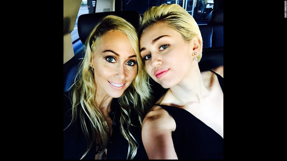 Miley Cyrus poses with her mother, Tish.