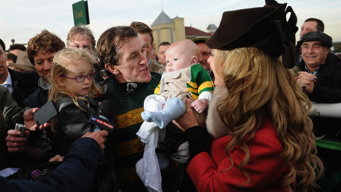 McCoy celebrates with his wife Chanelle and children Eve and Archie after being the first jump jockey past the 4,000 winners mark.