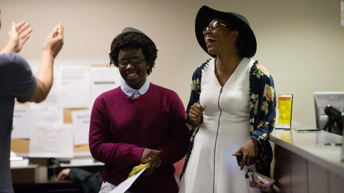 "Shante Wolfe, left, and Tori Sisson become the first same-sex couple to file their marriage license in Montgomery, Alabama, on February 9, 2015. However, seven months after the U.S. Supreme Court ruling legalizing such nuptials nationwide, Alabama <a href=""http://www.cnn.com/2016/01/06/politics/roy-moore-alabama-supreme-court/"" target=""_blank"">Chief Justice Roy Moore</a> directed probate judges in his state to enforce the ban on same-sex marriage. Gay rights organizations swiftly denounced Moore's January 6, 2016, order."