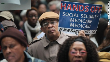 Demonstrators protest against cuts to federal safety net programs on November 7, 2011, in Chicago.