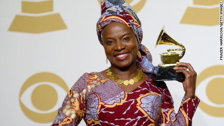 "Angelique Kidjo celebrates her win for ""Best World Music Album"" at the 57th Annual Grammy Awards at the Staples Center on February 8, 2015 in Los Angeles, California."