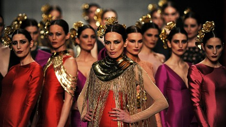 Models present creations by Vicky Martin Berrocal during the first day of the SIMOF (International Flamenco Fashion Show) in Sevilla, on February 5, 2015. AFP PHOTO/ CRISTINA QUICLER (Photo credit should read CRISTINA QUICLER/AFP/Getty Images